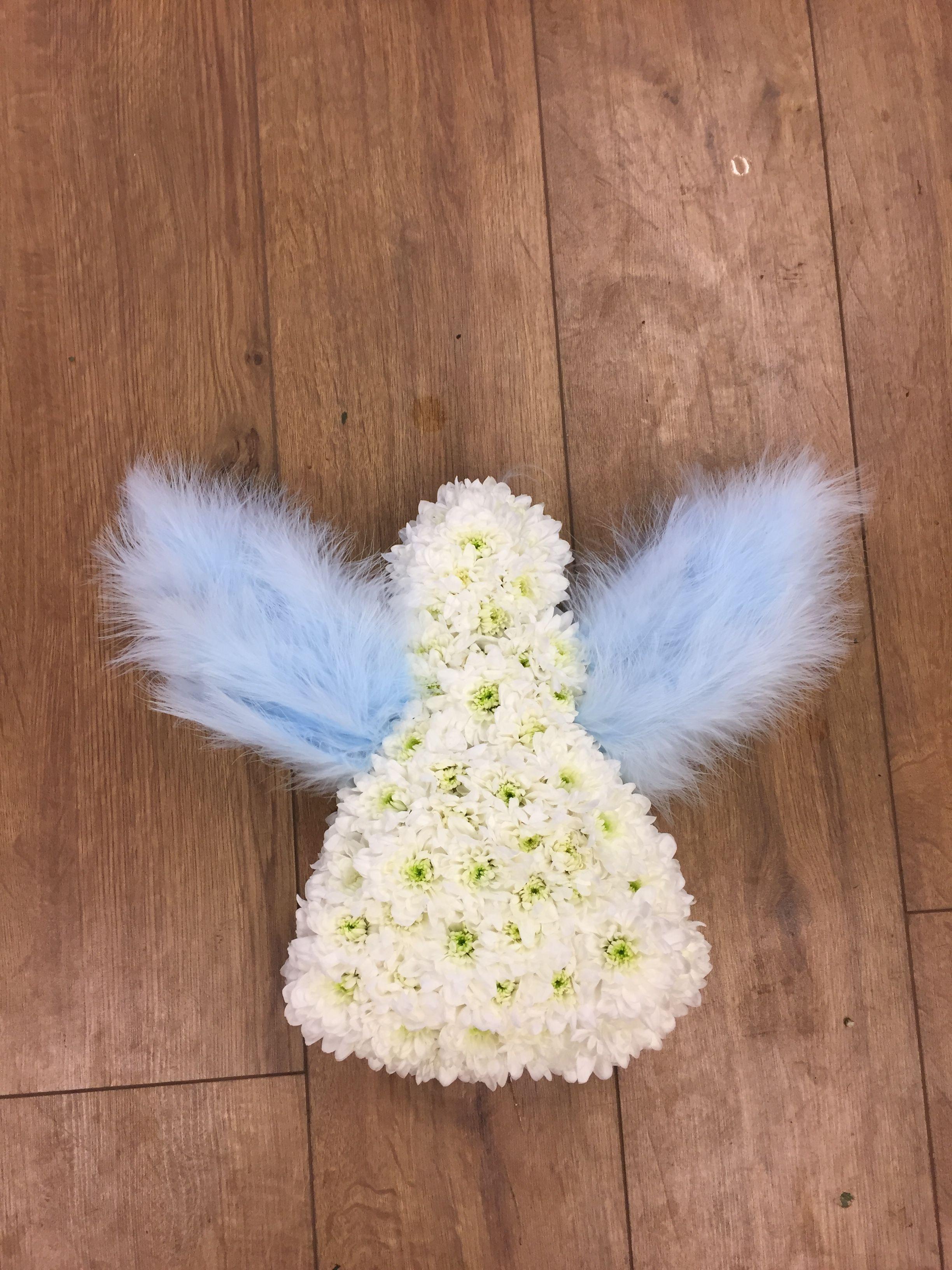 Mini angel funeral tribute based in white chrysanthemums blue mini angel funeral tribute based in white chrysanthemums blue feather wings made by izmirmasajfo