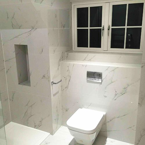 Bathrooms Walls And Floor Tiled With Carrara Marble Look Thin Porcelain Tiles. #marble