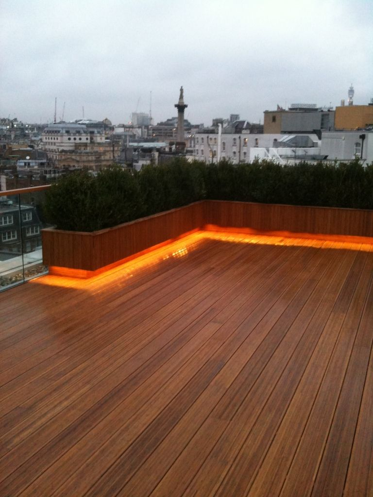 Bamboo Decking And Raised Bed Eith Lighting On Roof