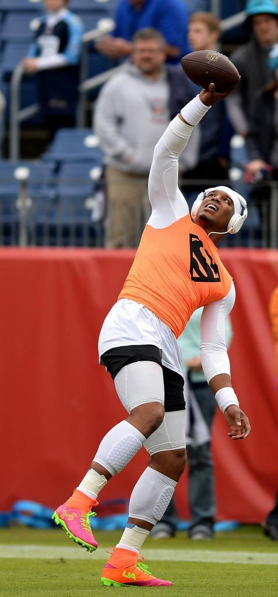 2d6c2700b6335c6aa0c019bf62948435 carolina panthers quarterback cam newton catches a thrown ball one