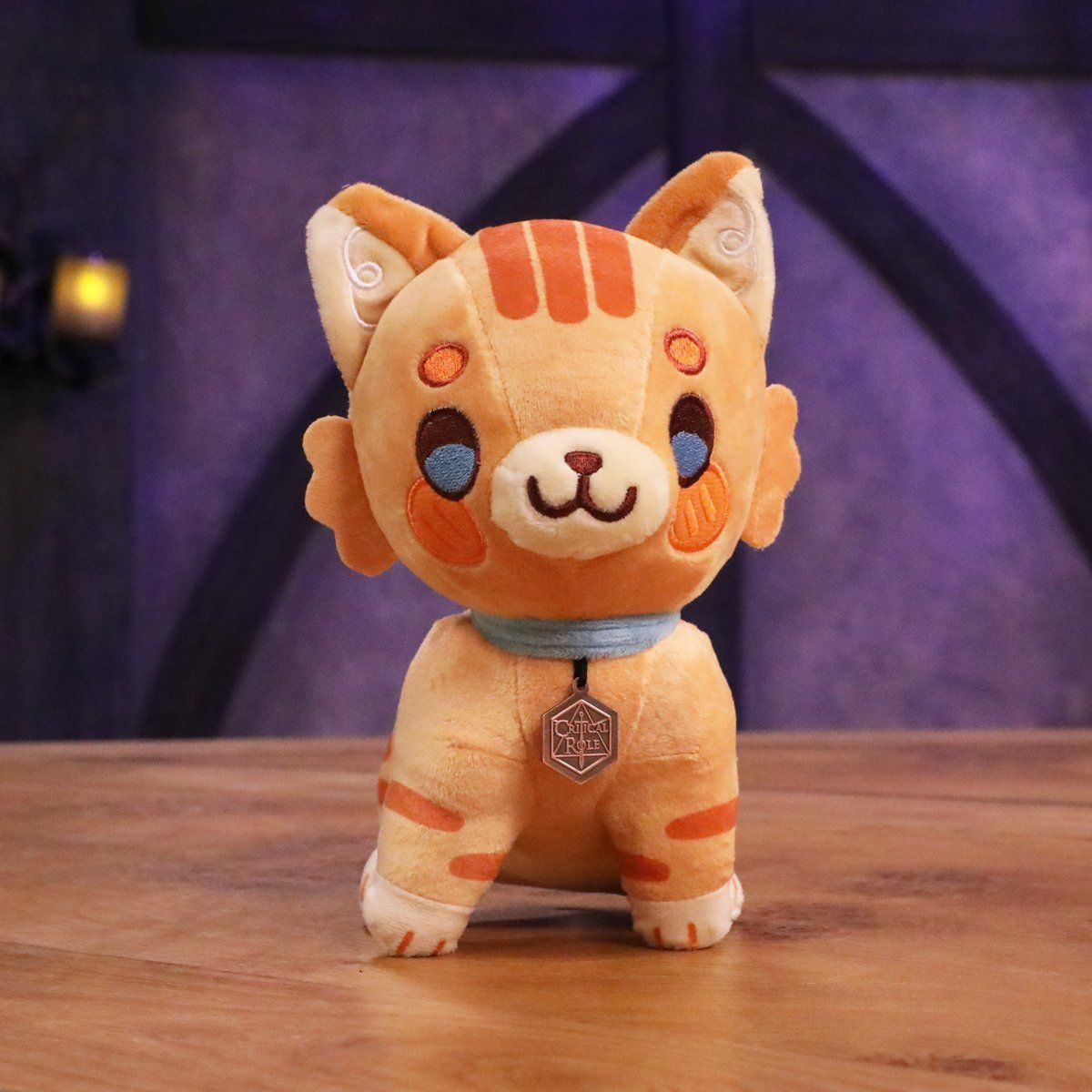Summon this adorable Frumpkin Plush  from the Feywild to your side! This super soft kitty features embroidered details and wears a felt collar with a metal charm with the Critical Role logo on one side and a