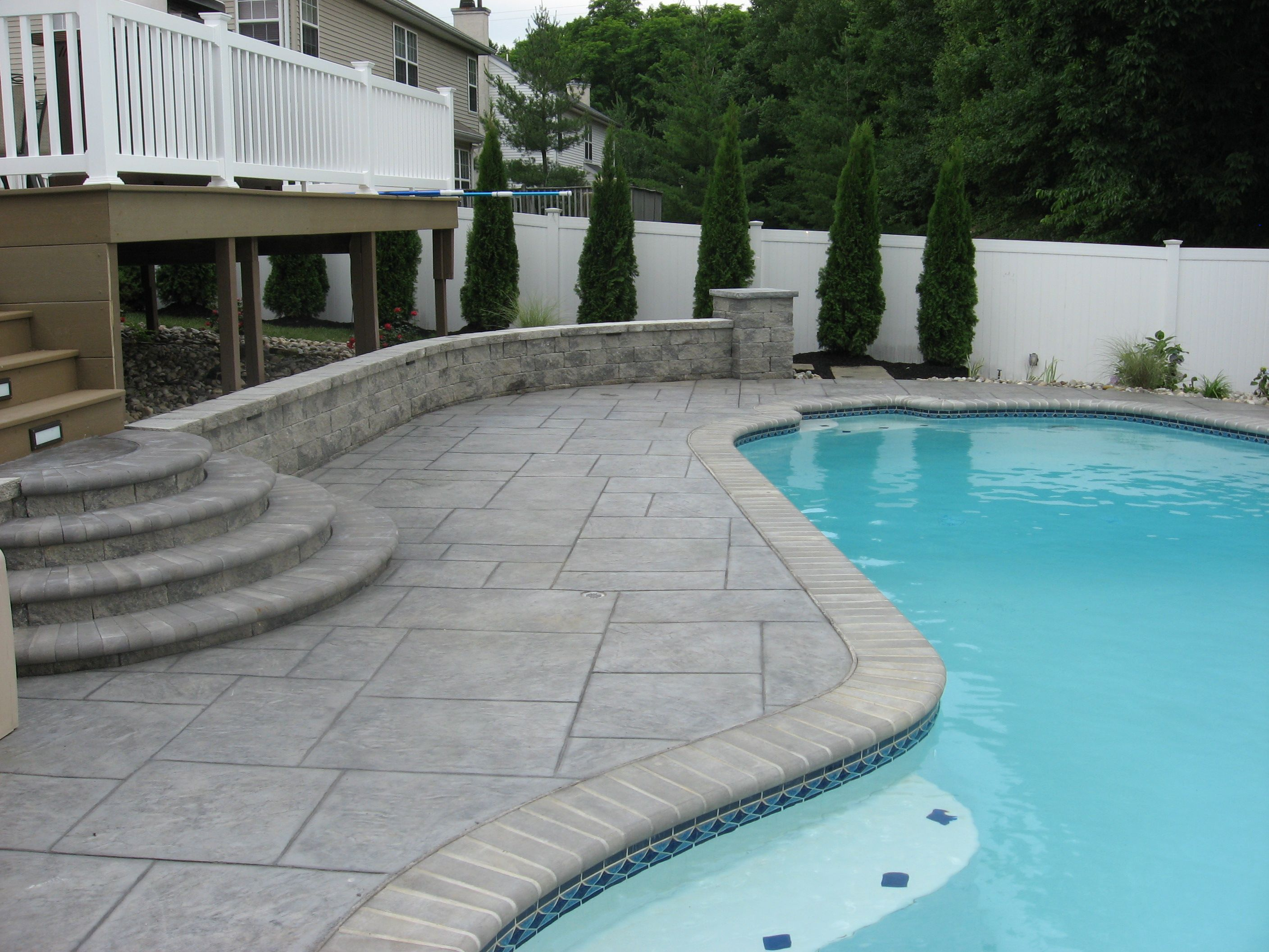 Stamped concrete patios around a pool pattern concrete for Pool and backyard design