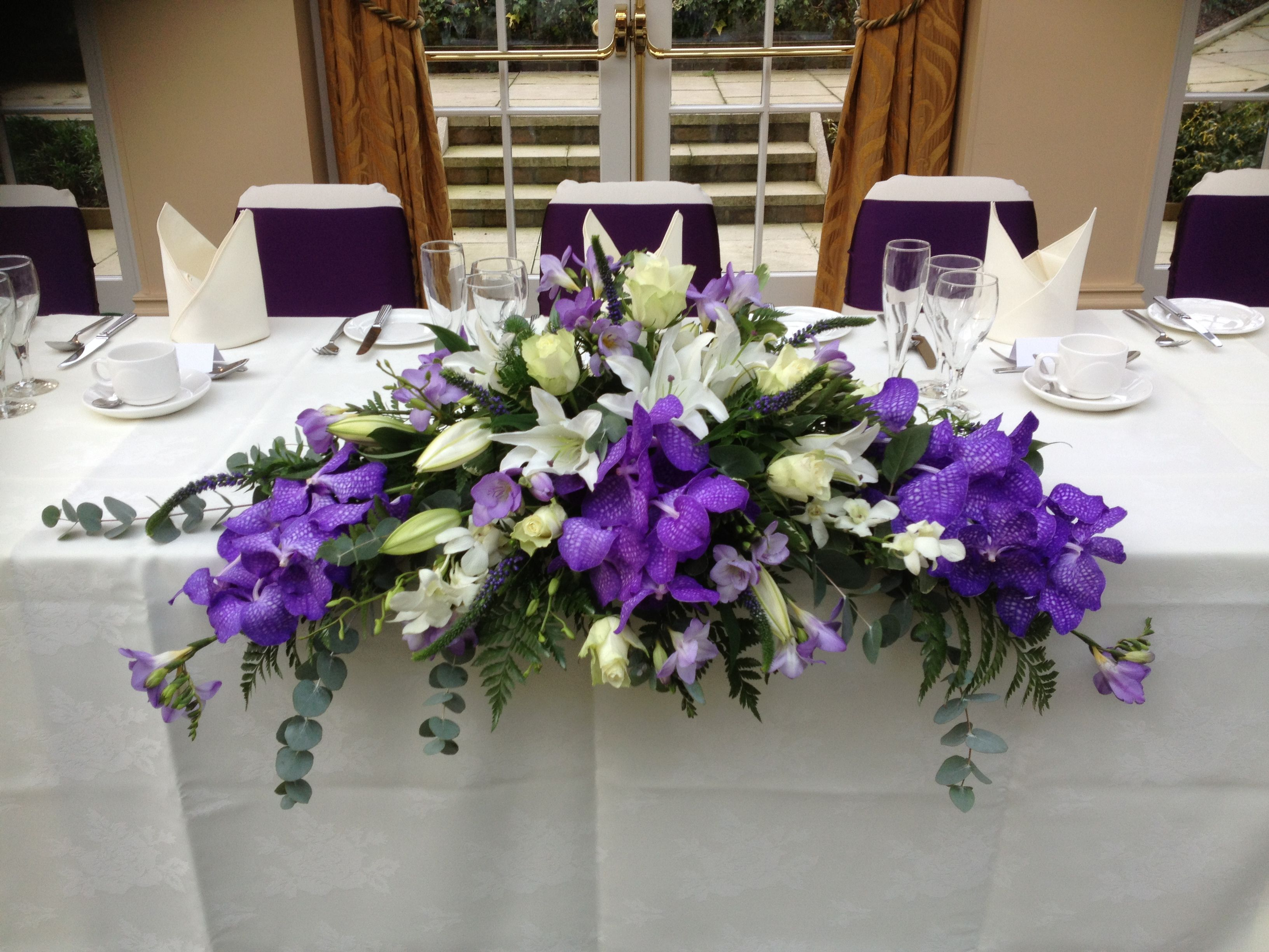 Beautiful Top Table Design With Vanda Orchids White Lilies And Lilac Freesia Top Table Flowers Wedding Table Flowers Wedding Top Table