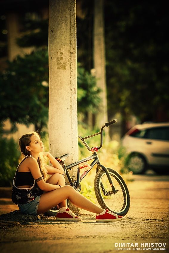Young girl with bmx on the sunset street bmx bmx girl and cycling young girl with bmx on the sunset street by dimitar hristov 54ka voltagebd Choice Image