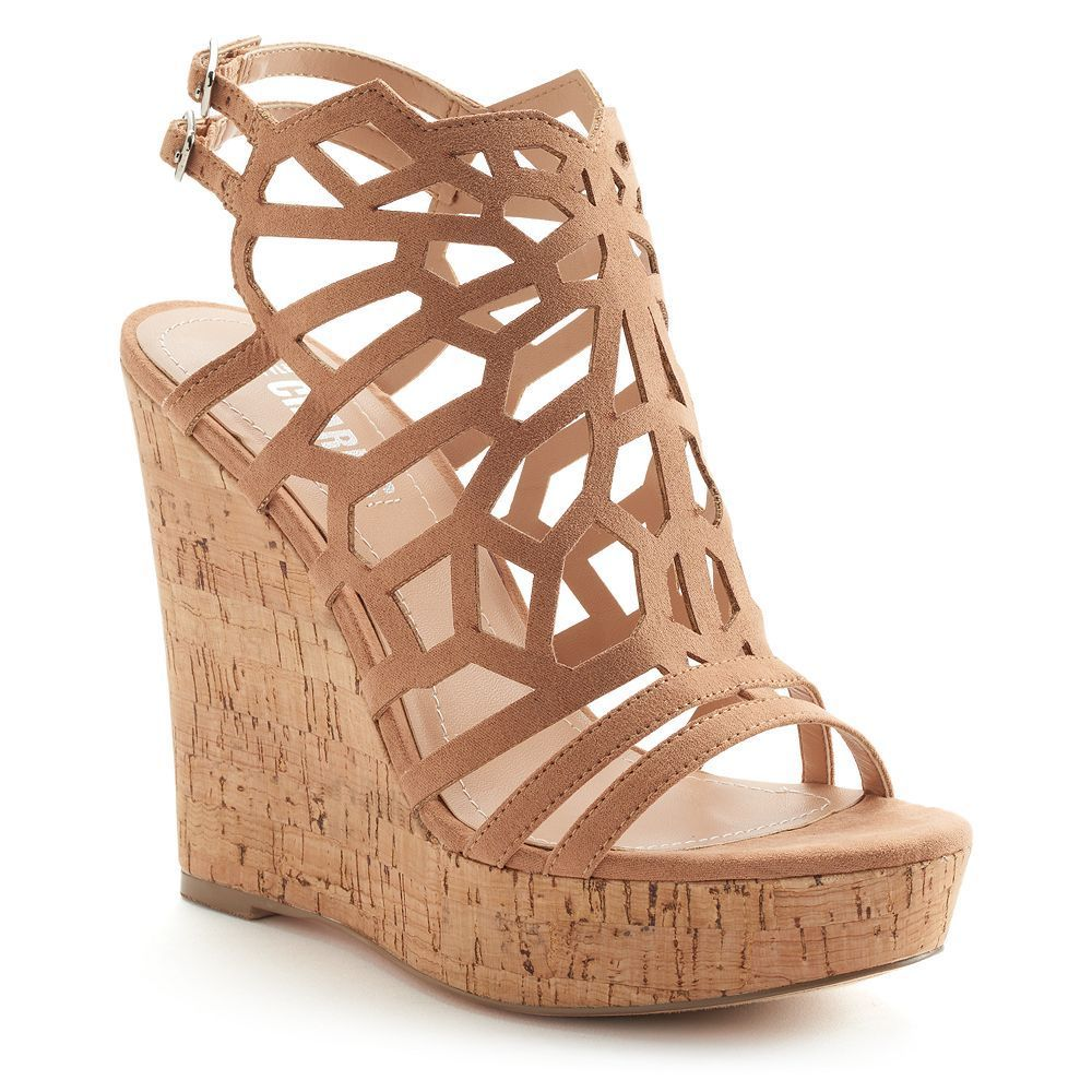 f9cef54a1 From the strappy upper to the cork-patterned wedge, these Apple sandals  keep things fun and flirty.