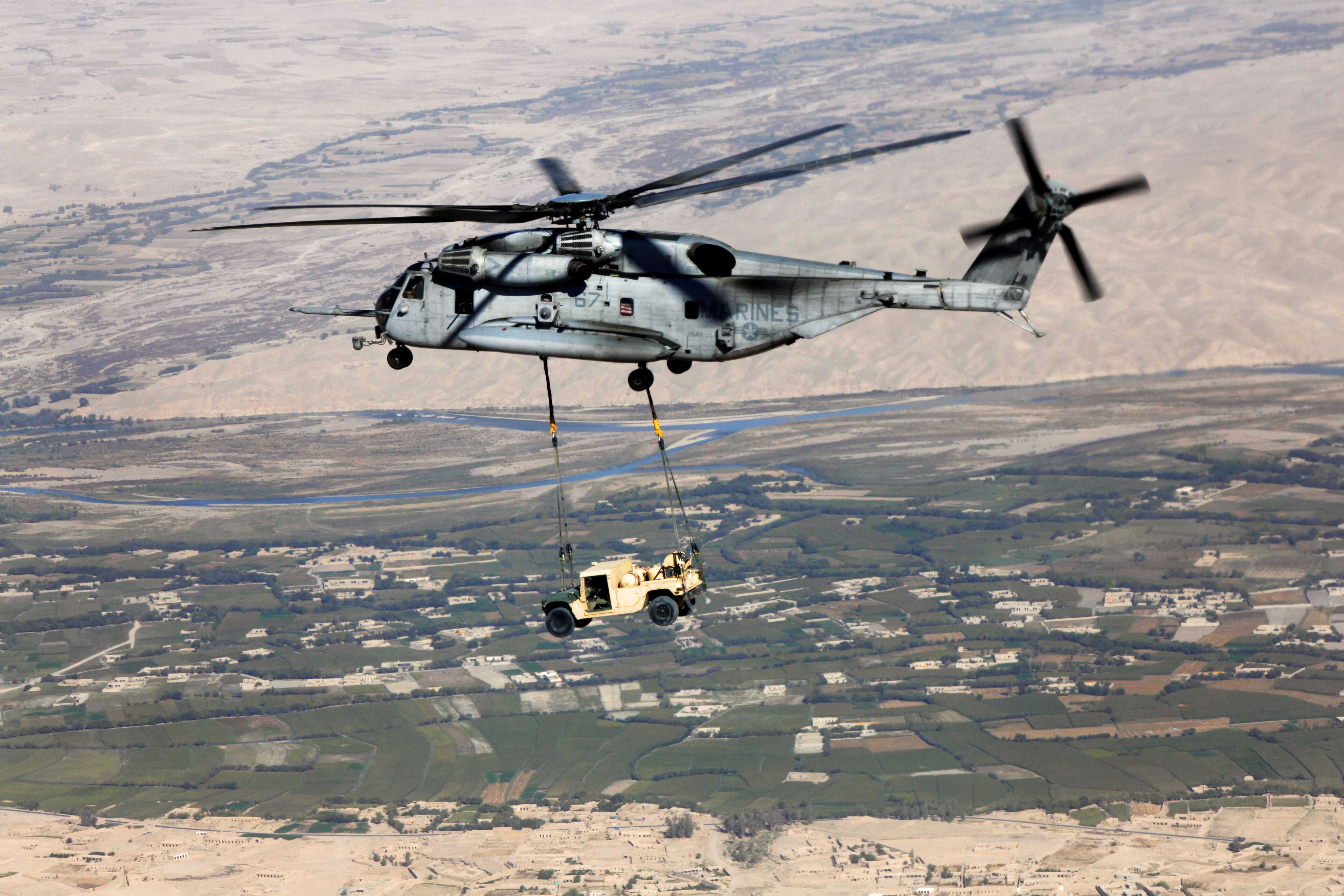 A CH-53E Super Stallion helicopter transports a high-mobility, multipurpose vehicle over Helmand province, Afghanistan, Oct. 7, 2013. U.S. Marine Corps photo by Sgt. Gabriela Garcia