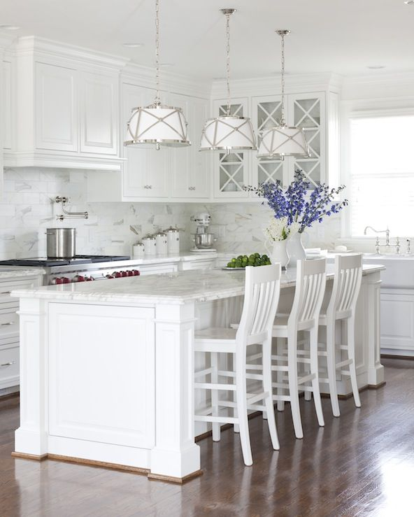Beautiful white kitchen design with white kitchen cabinets painted