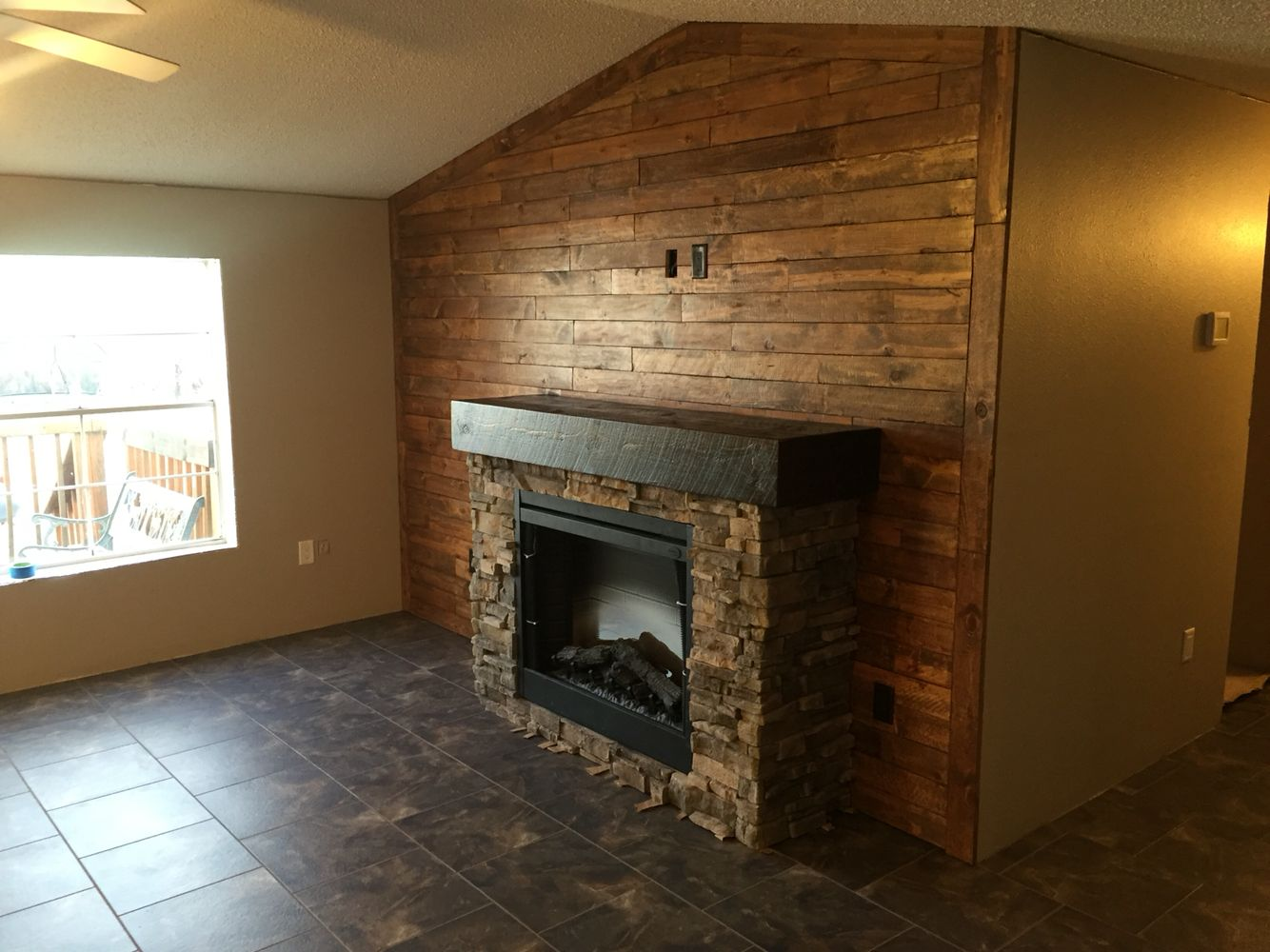 Pallet wall with rock fireplace rm construction pinterest rock