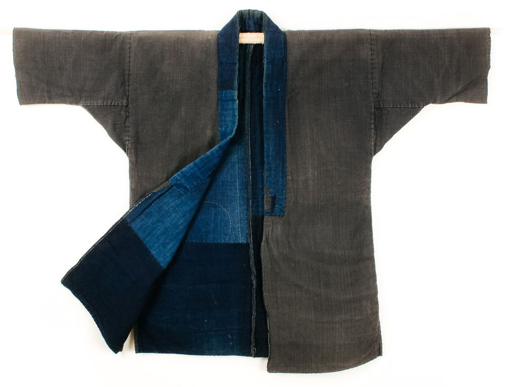 This is an antique Japanese workwear jacket called a noragi. The ...