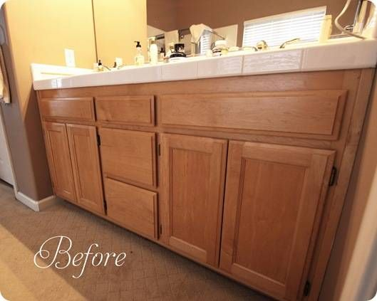 Painting Bathroom Oak Cabinets before: honey oak cabinets with a light color counter (basement