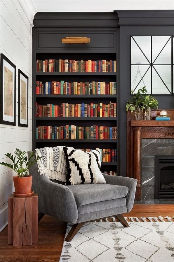Photo of I love all these books on the shelves and the color of the wall is dark and moo… – living room decoration