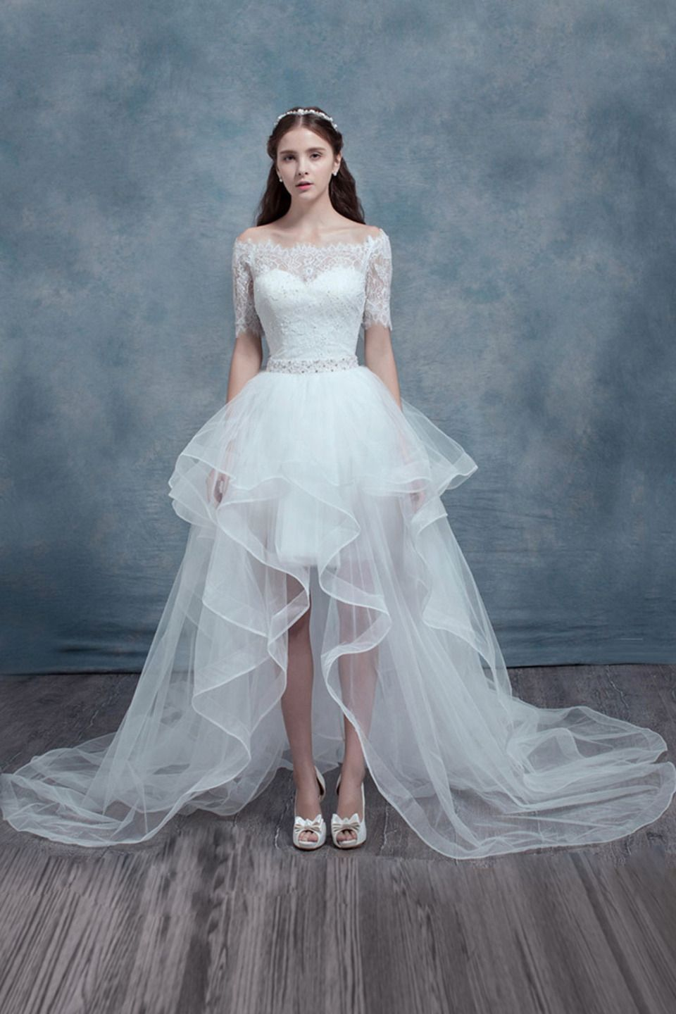 Few moda off the shoulder high low wedding gown in white