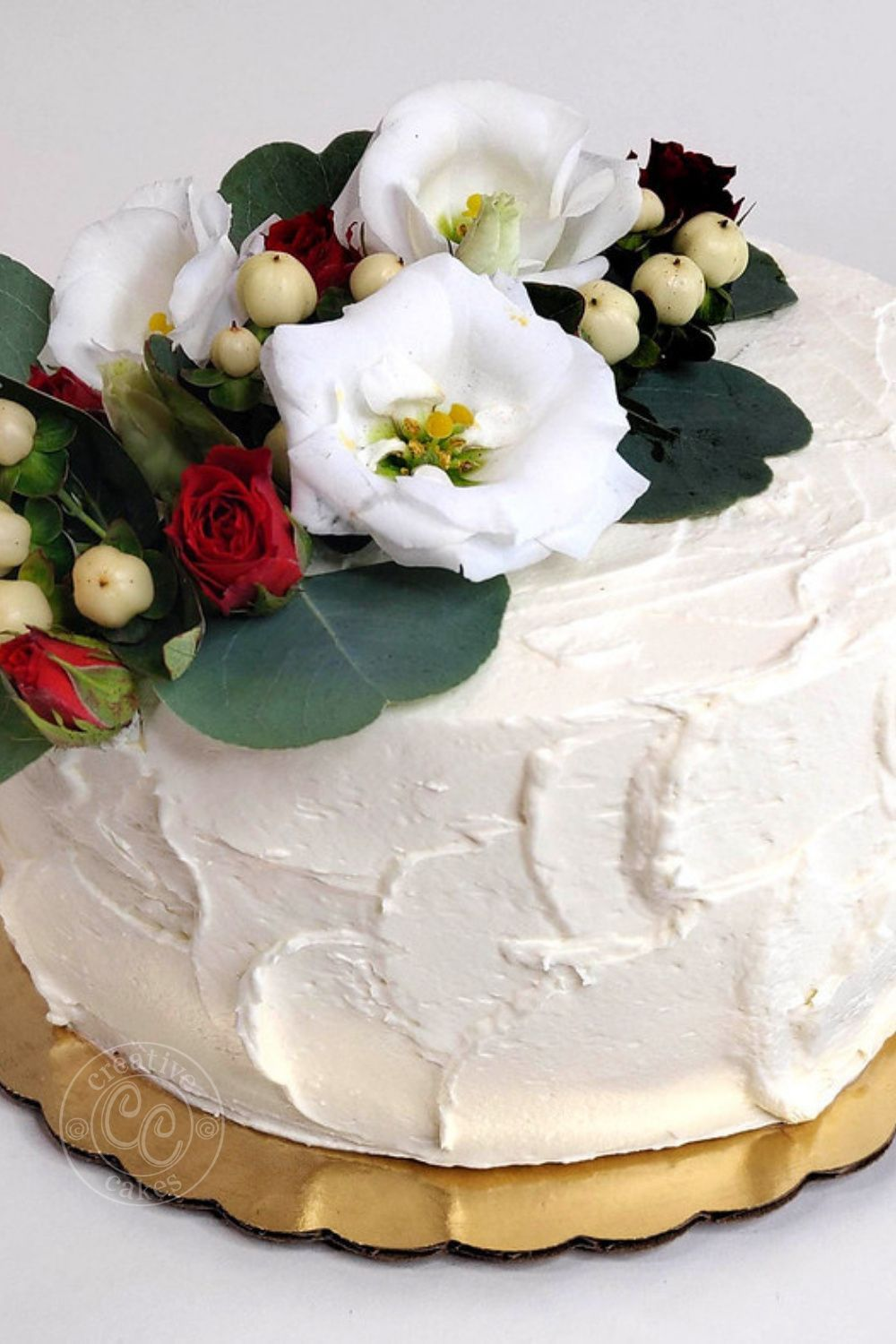 White Cake With Rustic Icing And Florals In 2020 Bakery Cakes Creative Cakes Cake