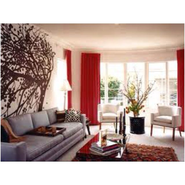 Red Curtain Grey Couch White Arm Chair Black Artwork Living