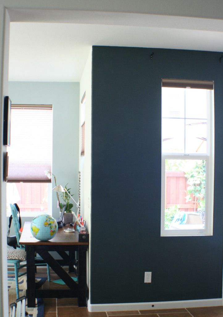 Paint an accent wall a dark color for instant drama!