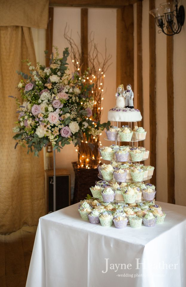 Cupcake wedding cake with knitted cake toppers at Vaulty Manor, Essex, reportage - documentary-style photography by Jayne Heather - Wedding Photojournalism