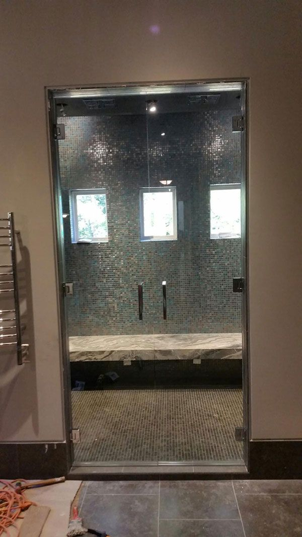 Frameless Shower Door With Decorative Glass Installed In A Business