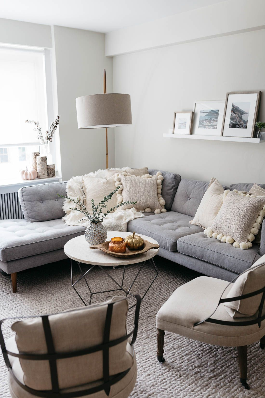 Nyc Living Room Apartment Grey Sectional Sofa With A Marble Coffee Table And Cheap Living Room Furniture Cheap Living Room Sets White Furniture Living Room