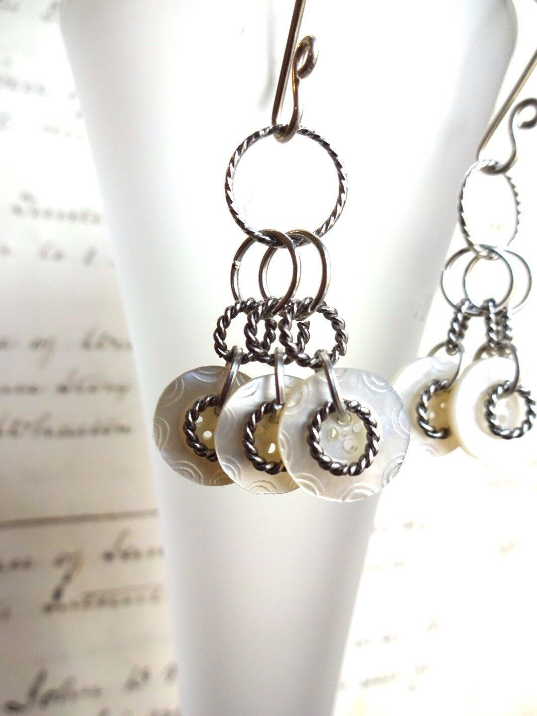 A new look in my Etsy shop https://www.etsy.com/listing/269944860/vintage-button-earrings-carved-white