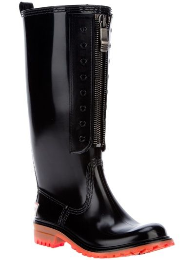 Black leather rain boots from Dsquared2 featuring an upturned toe, red sole and block heel and front zip.