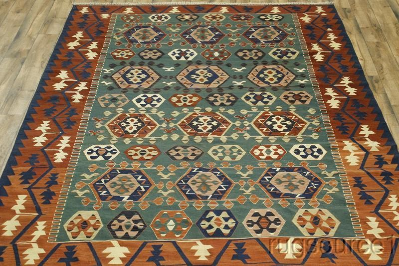 Item No : R-5210  Style: Kilim   Made In Turkey  100% Wool  Green,Red, Blue, Rust, Peach, Cream  12' 0'' X 8' 11''  Condition :- Excellent  Woven :- Hand Woven