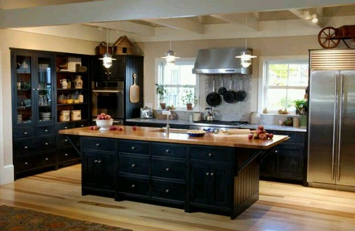 Black Cabinet With Warm Wood Tones And Striking Stainless Steel
