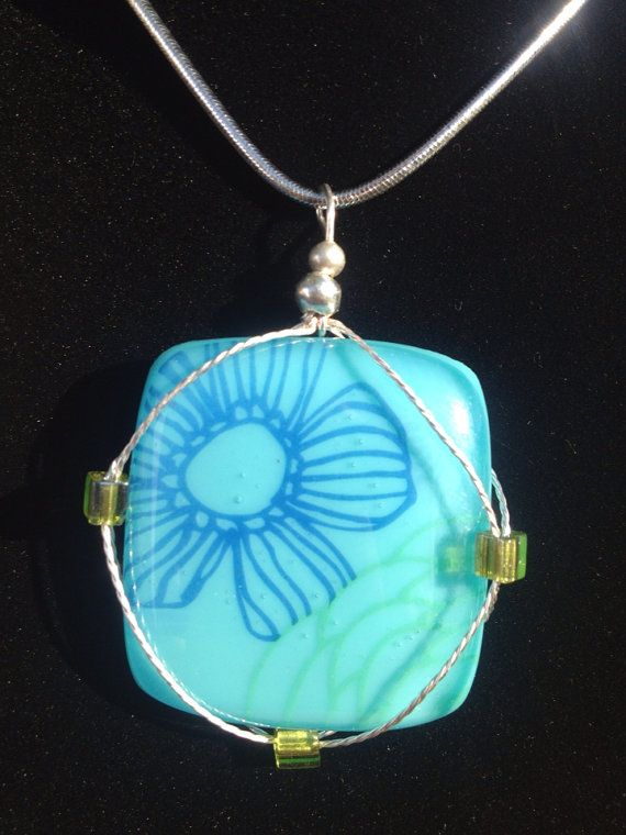 blue pendant wire wrapped with flowers