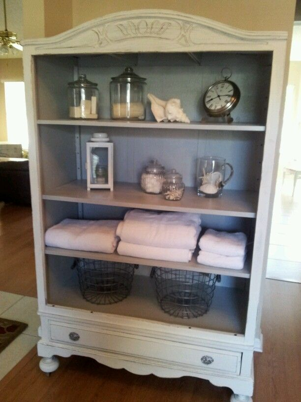 Armoire repurposed! By taking the doors off you get a whole new look ...