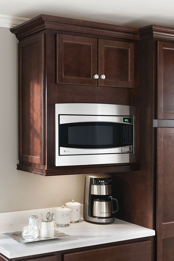 A Wall BuiltIn Microwave Cabinet keeps counter clear and