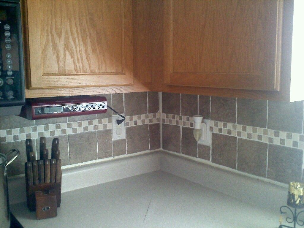 Clearance tiles at Lowes + cheap tile cutter = $60 backsplash ...