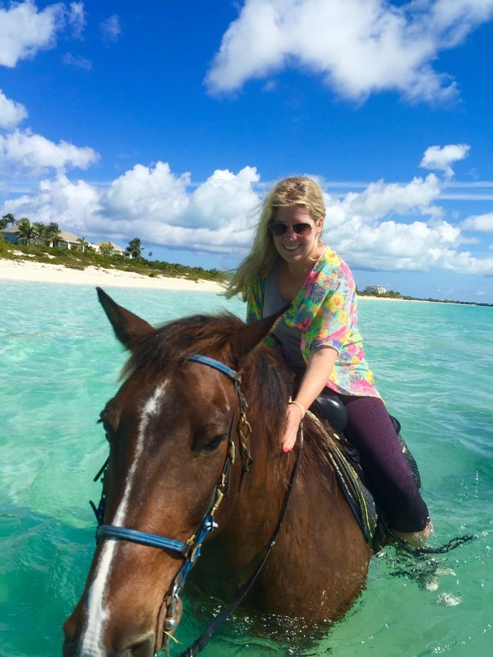 Horseback riding on the beach on Provo, Turks and Caicos