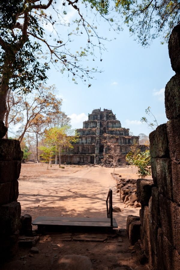 Koh Ker is a remote temple immersed within the jungle of Preah Vihear province in Cambodia. You can climb the several flights to the top with beautiful views all around. It's worth the day trip from Siem Reap! #kohker #temples #amazingarchitecture #cambodiatravel #khmer #destination #travelinspiration #mustsee #travelguide