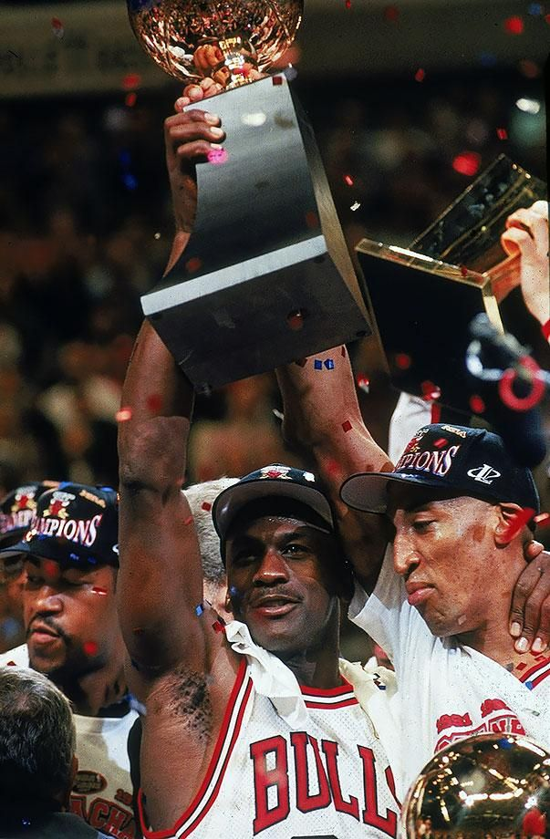 Michael Jordan And Scottie Pippen Hold Up The Championship Trophy After Chicago Bulls Victory Over Utah Jazz In Game 6 Of NBA Finals On June 13