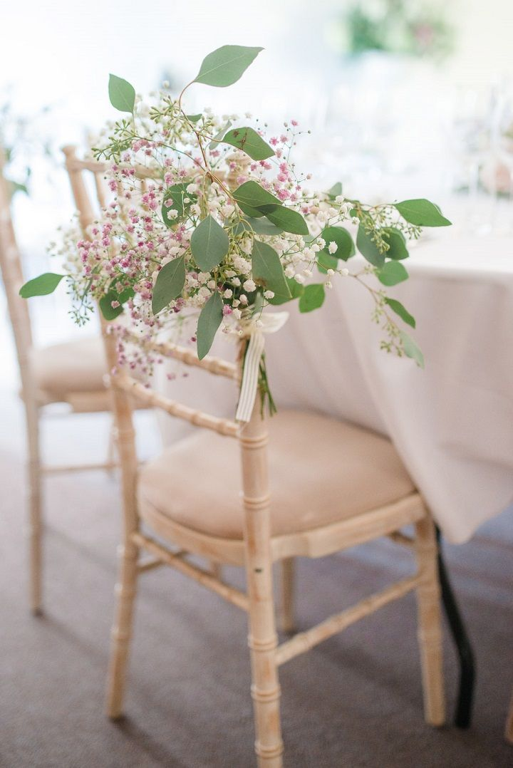 Pretty wedding chair decorated with pretty flowers