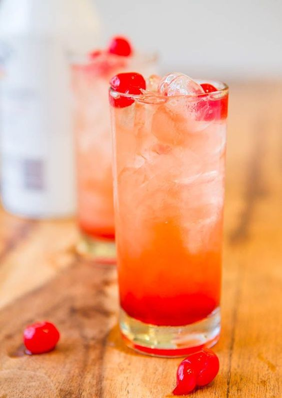Malibu Sunset {Pineapple-Orange Juice, Malibu Coconut Rum, Grenadine, & Maraschino Cherries}