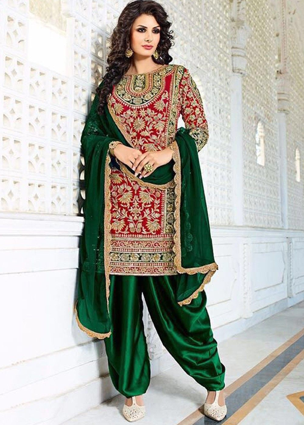 4e5a7441ad Look gorgeous by wearing this #red and #green combination #punjabi #suit for  your special ocassion richly crafted in #silk with zardozi and gota patti  work.