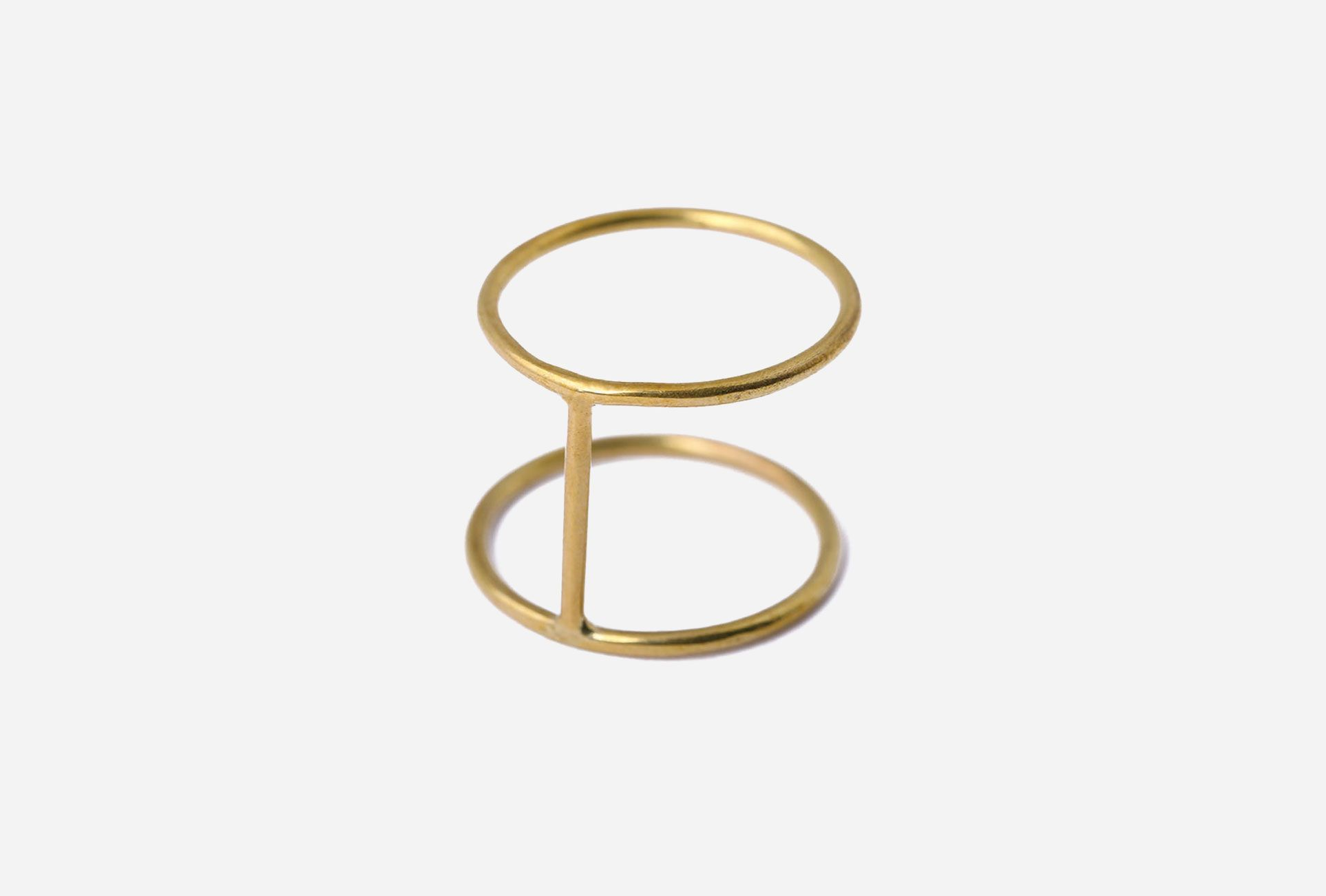 Bring out your edgier side and adorn you finger with this delicate cage ring. Handmade from brass by artisans in Kenya, add some spice to your accessories with