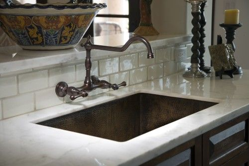 Create An Old World Look With Dark Wood Painted Tile Arches And More Hacienda Kitchen Copper Kitchen Sink Spanish Revival Kitchen