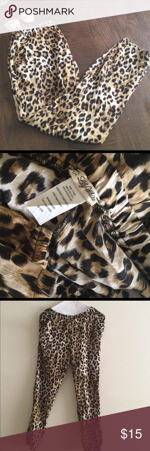 """Lily white Leopard pants Used twice,size S waist 28"""". Loose fit but fitted at bottom. Great color combination. Look great with flats or heels. No trading. Will take offers. Lily White Pants Trousers"""