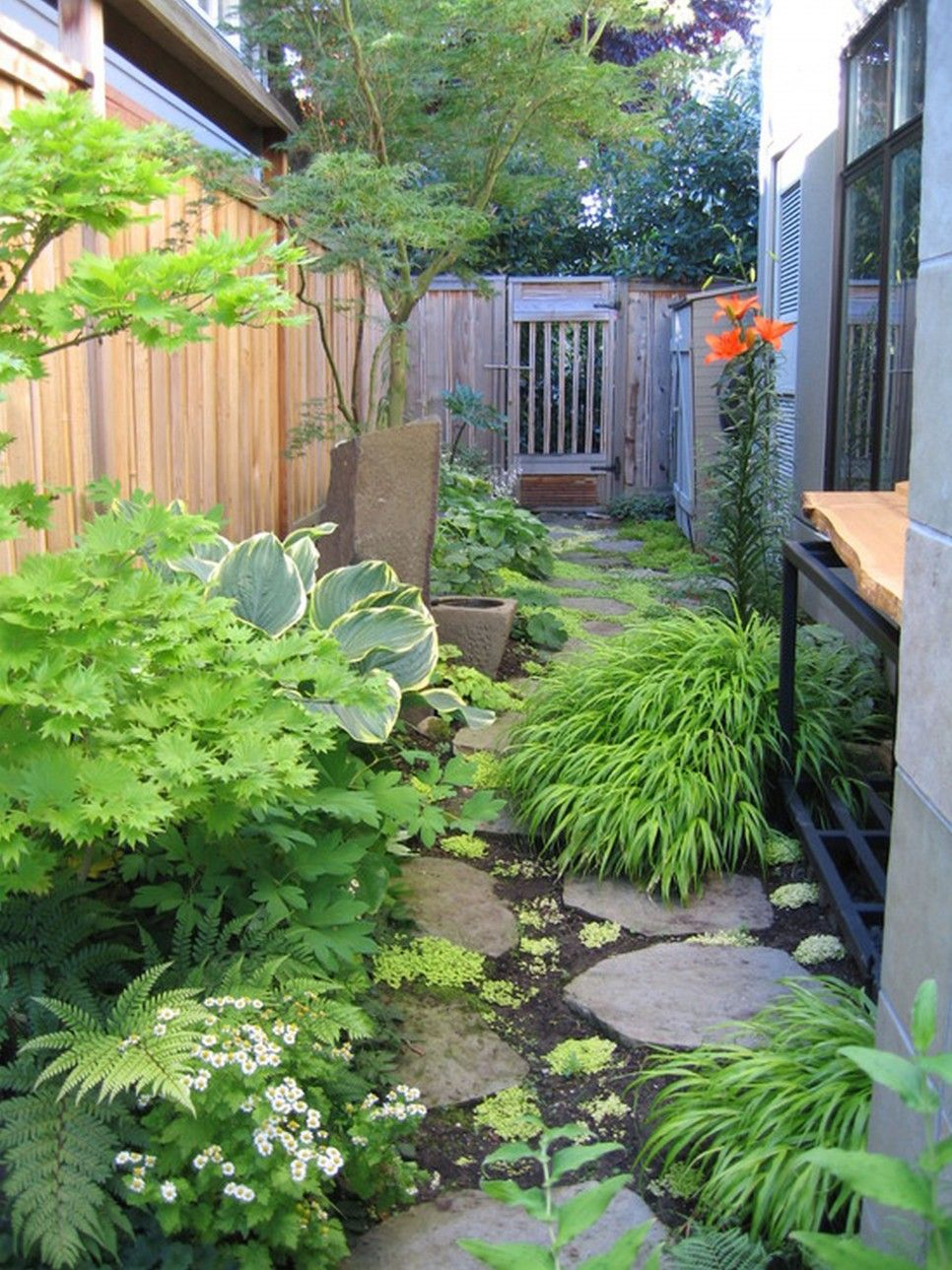 Garden And Patio Narrow Side Yard Garden House Design With Vegetable Garden Plants And Stone Footpat Side Yard Landscaping Backyard Garden Beautiful Backyards Backyard garden house plans