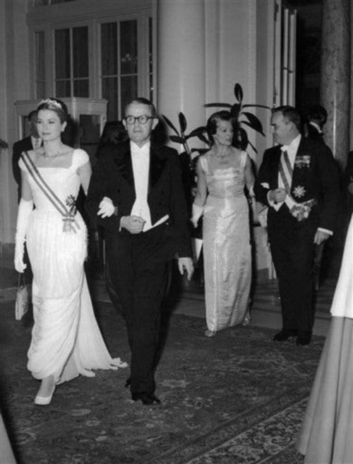President Max Petitpierre of Switzerland escorts Princess Grace of Monaco into dinner during a state banquet in the Bellevue Palace in Berne, Switzerland on Nov. 8, 1960. They are followed by Prince Rainier III and Madame Petitpierre.