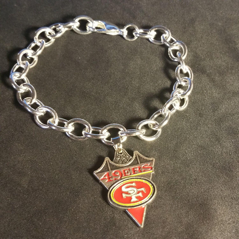 6ec2dad62c6f6 San Francisco 49ers Dangling Charm Bracelet by DesignsByKehau on Etsy