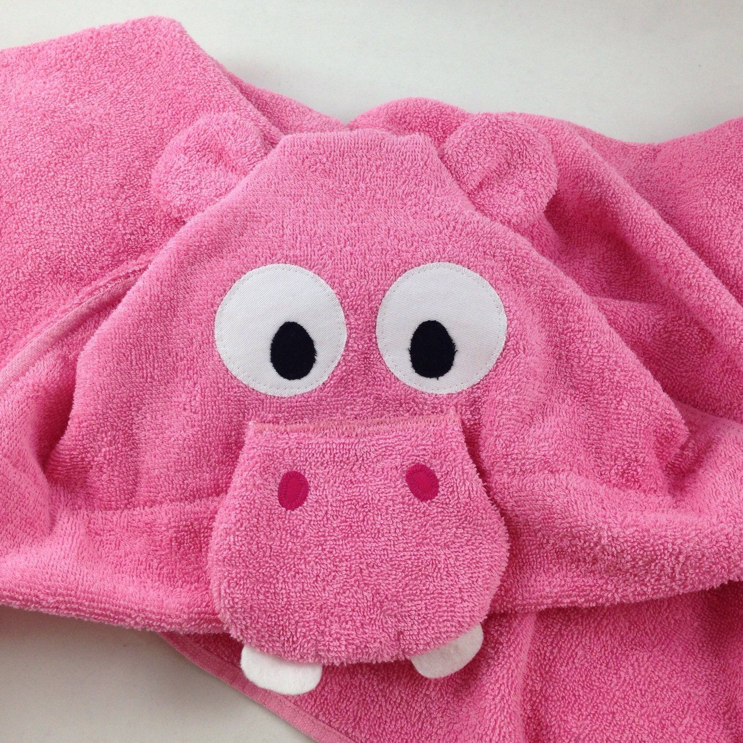 The newest addition to our hooded towel collection. An adorable hippo!