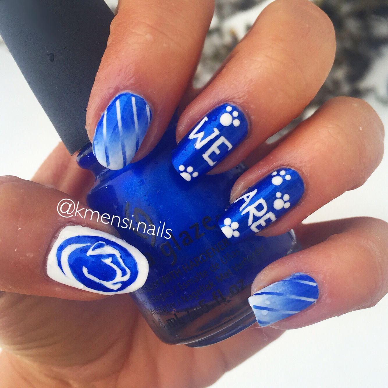 """Penn state """"We Are"""" nail art using china glaze frostbite by @kmensi.nails"""
