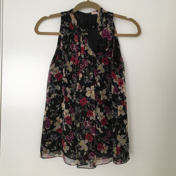 Rebecca Taylor Sleeveless Blouse Beautiful floral print double layer chiffon (not see through) sleeveless high neck blouse. Abstract floral appliqué and pleated neck with hook and eye closure as well as a self tie at back neck. Rebecca Taylor Tops Blouses