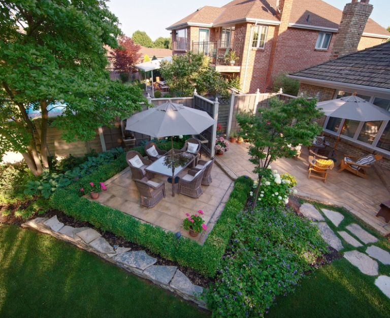 Split Level Patio. Boxwood Plantings Define The Eating Area. Flagstone  Walkway Is Repeated In