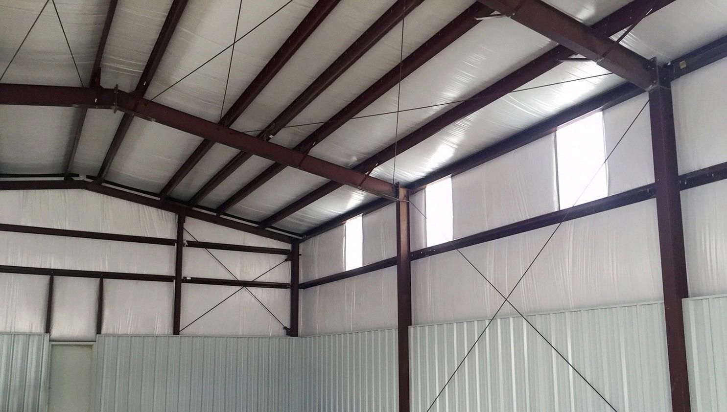 See these metal buildings with carport attachments.
