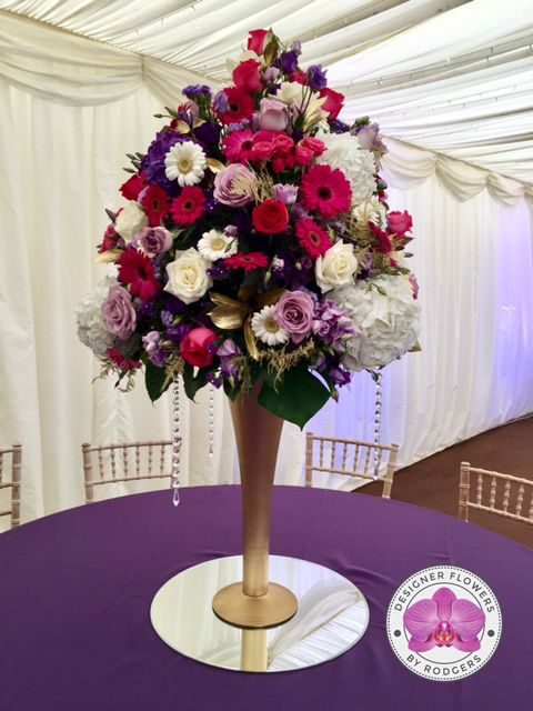 Perfect Table Centre Pieces   Designed On Tall Gold Trumpet Vases Sat On Mirrors.  White Avalanche Roses, Deep Purple And Lilac Lisianthus, White And Purple  ...