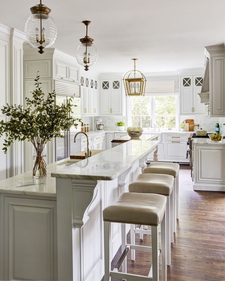 Best White Kitchen With Wood Floors And Brass Lights Warm 400 x 300