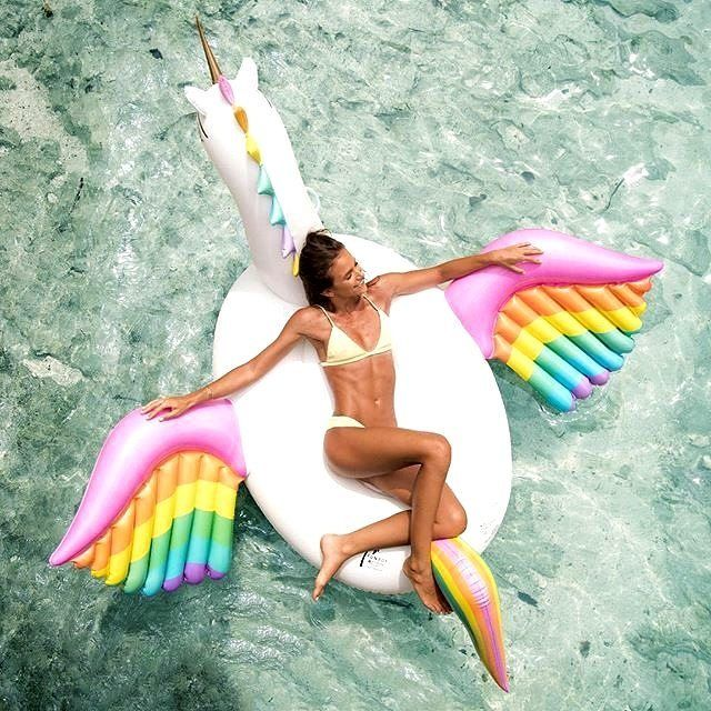 When you're still stuck in the office, but should really be chillin on this big unicorn...    Happy Friday! ---------------------------------------------- SkinnyMint is now at 20% off with the code SUMMER20! Link in bio  #MySkinnyMintSummer #Summerlovin : @funboylife @helenowen